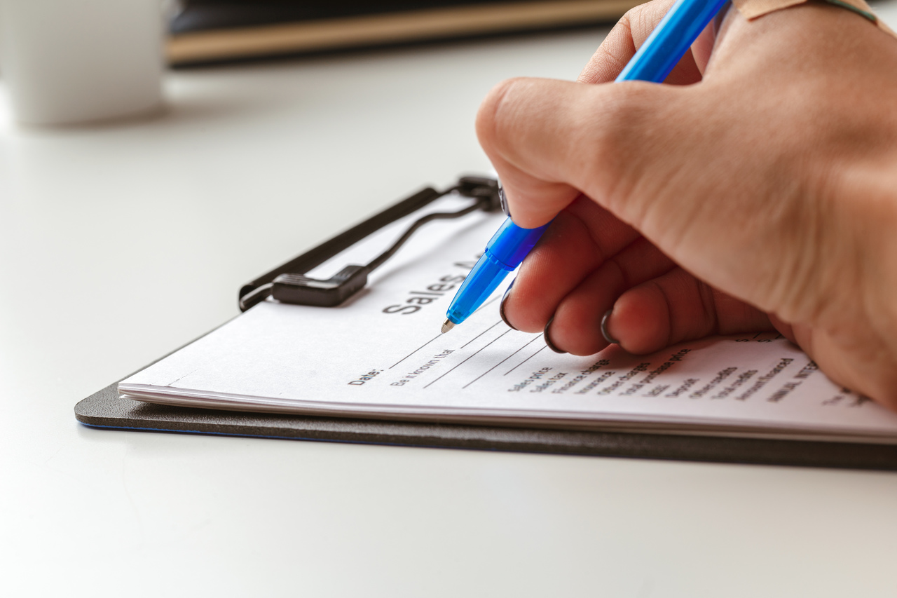 contract form, selling and buying home or condo concept