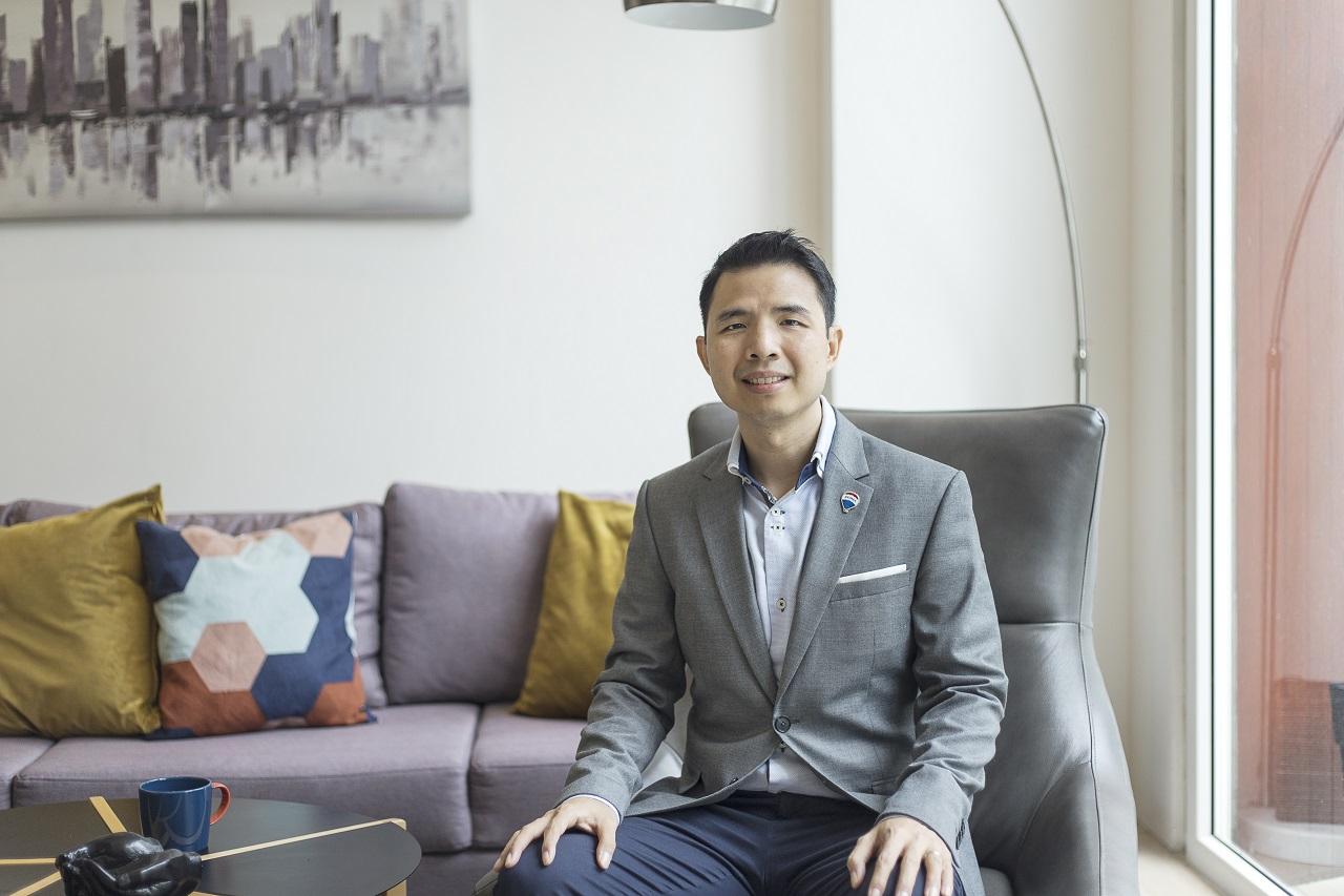 handsome real estate broker sitting on sofa