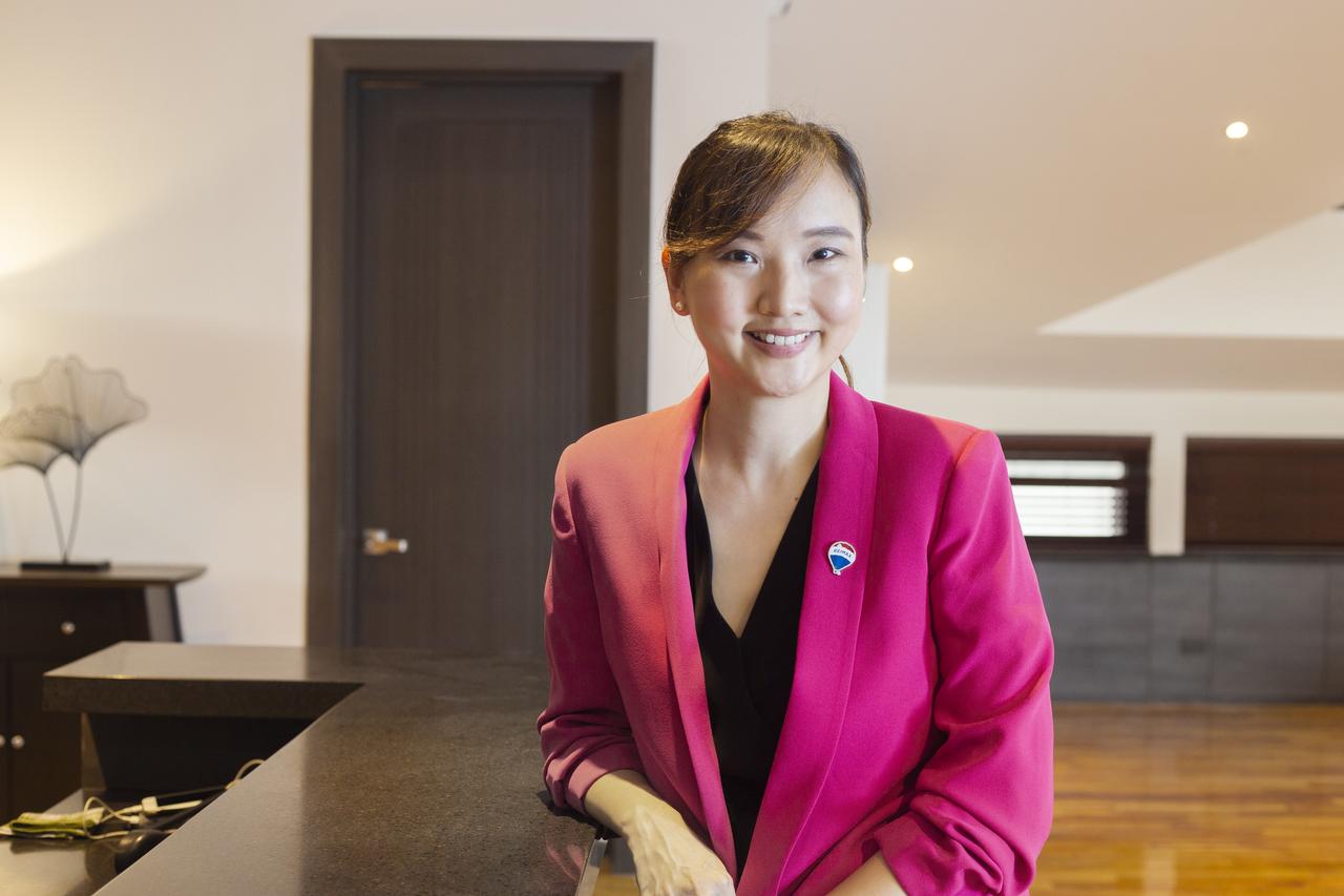 daphne yu wearing a pink blazer