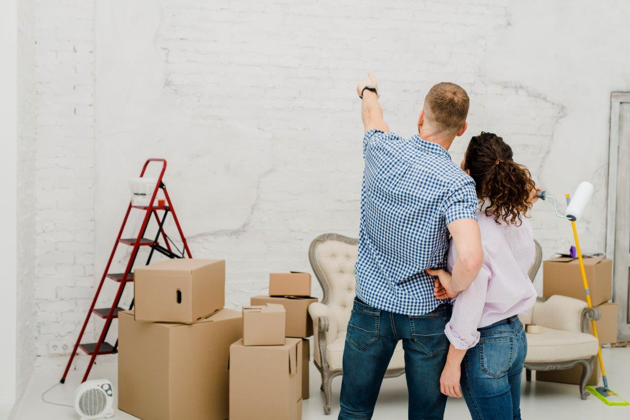 man and woman planning home renovation