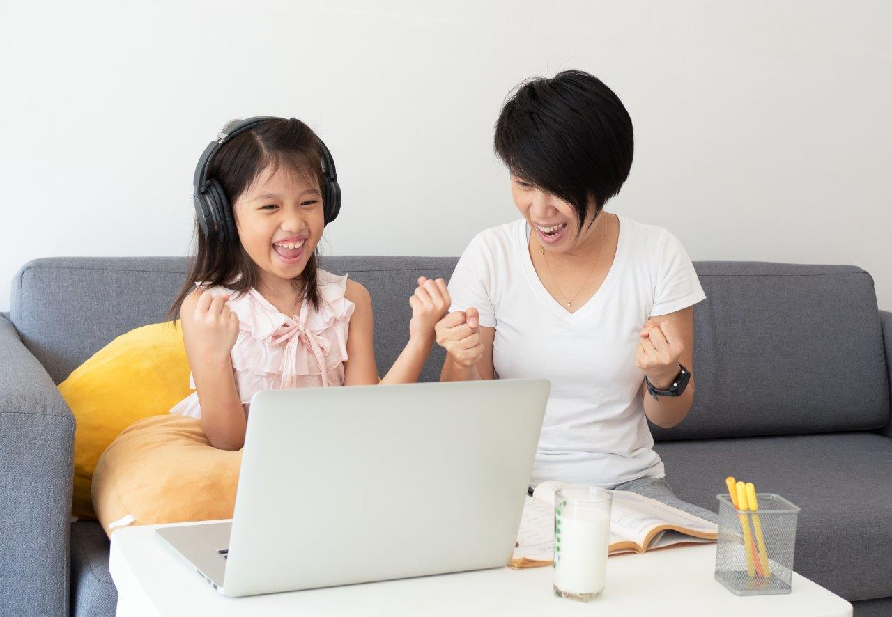 mother and daughter on a laptop