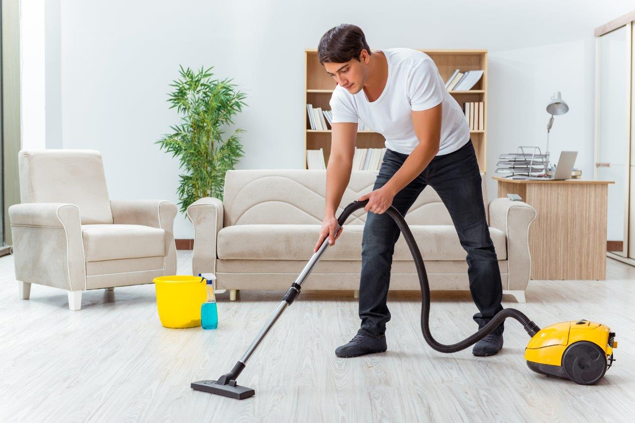 man vacuuming floors