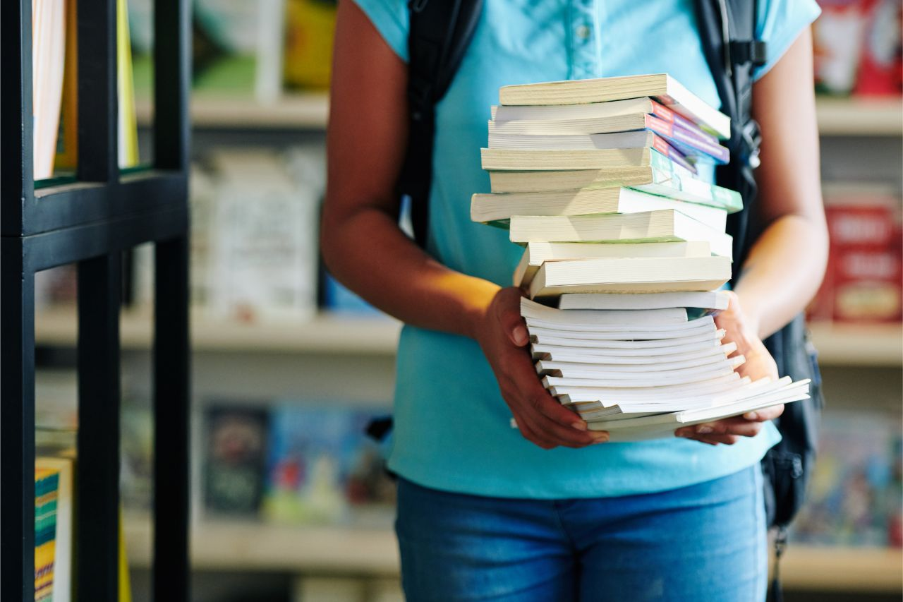 A girl with a stack of books she bought