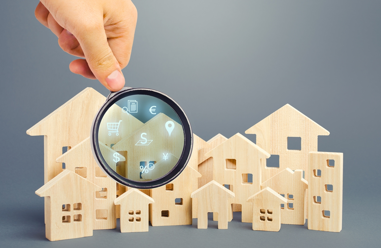 Magnifying glass hovering through homes